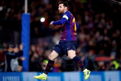 Barcelona's Lionel Messi kisses post on beautifully bent free kick