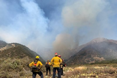 Firefighters set controlled fires around 32,400-acre Apple Fire