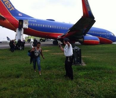 Southwest flight's nose gear collapses, shuts down La Guardia