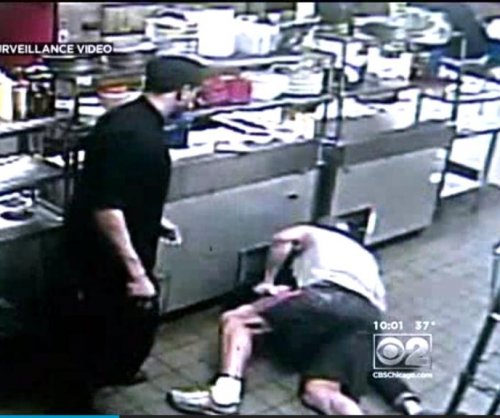 Wrestling-themed restaurant owner body slams armed man