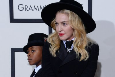 Madonna, son David perform 'songs for peace' near Paris attack site