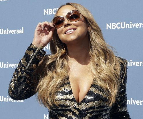 Mariah Carey's new beau Bryan Tanaka speaks out: 'I love her so much'