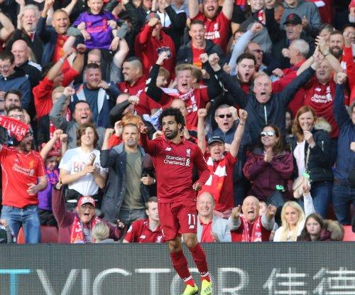 Mohamed Salah lifts Liverpool past Huddersfield