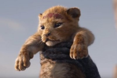 Rafiki holds up Simba on Pride Rock in first 'Lion King' teaser