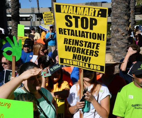 Activists and Walmart employees rally on Black Friday