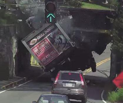 Truck bursts on hitting low Massachusetts railroad bridge