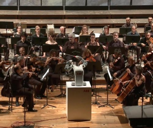 Swiss robot conducts orchestra in Italy