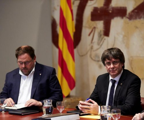 Catalan president delays independence declaration, asks for talks