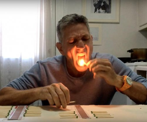 NY man breaks world record for extinguishing matches with tongue