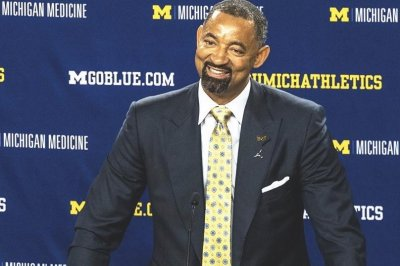 Michigan coach Juwan Howard cries at first news conference