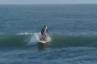 Socially distanced Surfing Santas take to the waves in Florida