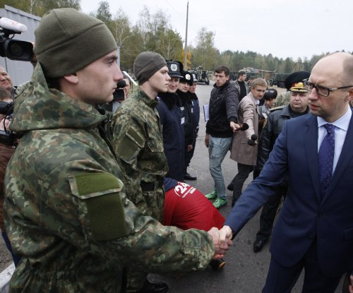 Embattled Ukrainian Prime Minister Yatsenyuk announces resignation