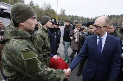 Embattled Ukrainian Prime Minister Yatsenyuk announces resignation