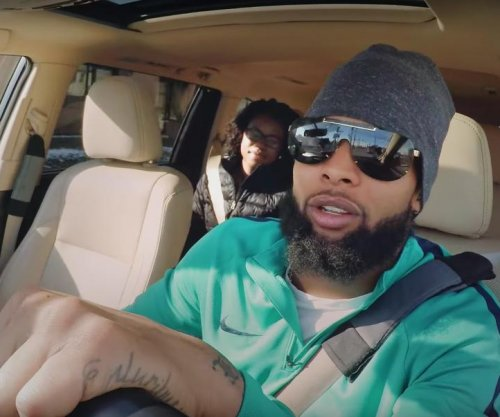 New York Giants' Odell Beckham Jr. poses as Lyft driver