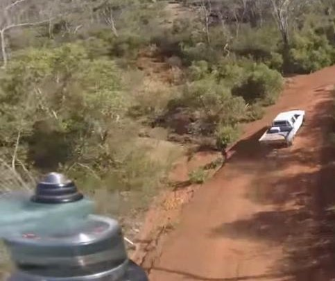 Crashing drone lands safely in bed of pickup truck