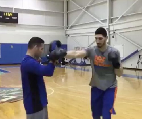 UFC's Weidman training Knicks' Kanter, calls out LeBron