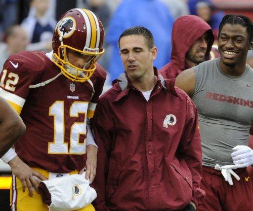 Washington Redskins QB Kirk Cousins reluctantly signs $24M franchise tender