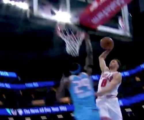 Bulls' LaVine dunks all over Kings' Sampson