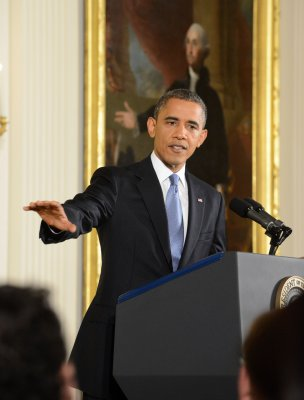 Obama calls criticism of Rice 'outrageous'