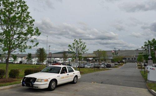 Veteran local official dies when car hits supermarket