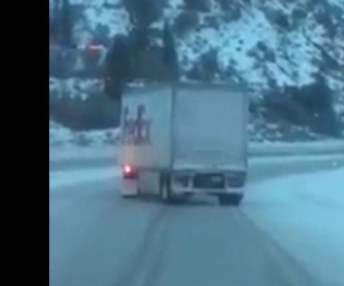 FedEx truck carefully slides down icy mountain road after trailer brakes lock