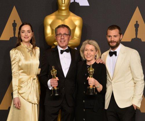 Jamie Dornan, Dakota Johnson reunite at 2017 Oscars