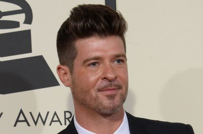 Robin Thicke engaged to girlfriend April Love Geary