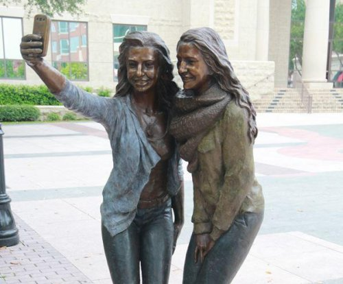 Texas city builds sculpture of two girls taking a selfie