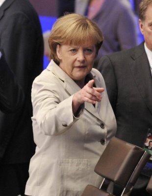 Merkel shoots down eurobonds and bank aid