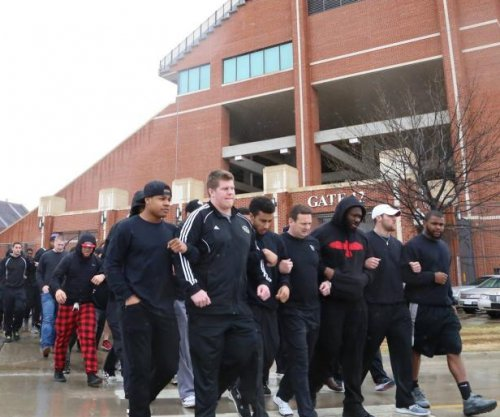 OU football team holds silent protests instead of practices over racist video