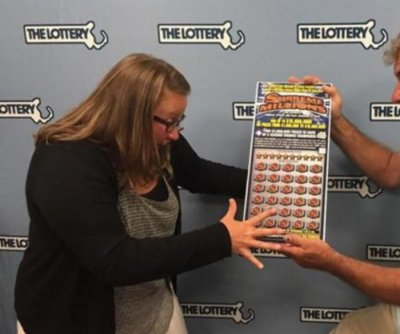 Massachusetts newlyweds take home $15M lottery prize