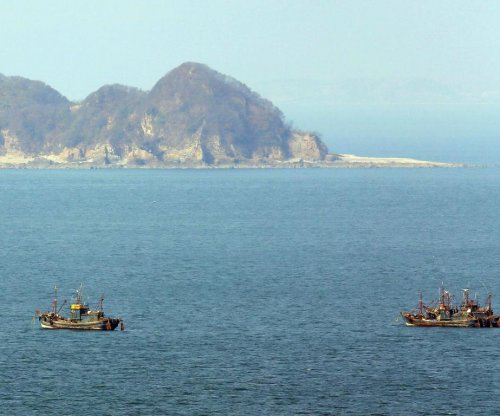 South Korea fires warning shots at boat from North