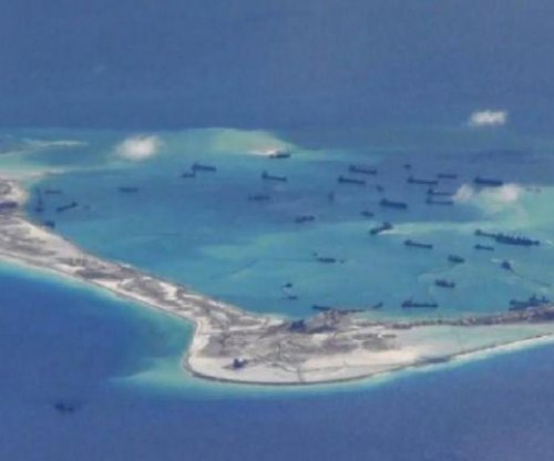 China opens lighthouses on disputed islands