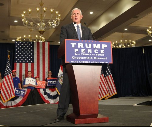 Mike Pence's controversial record overshadowed by Donald Trump