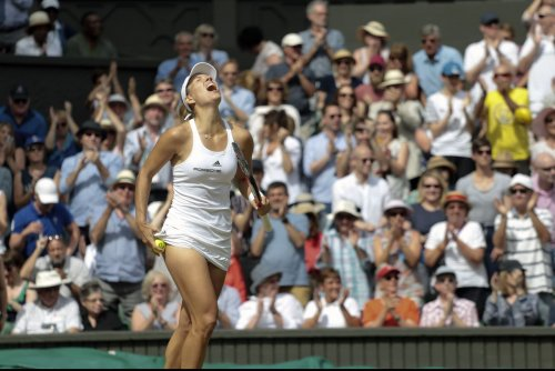 Angelique Kerber tops Monica Puig, advances to quarterfinals in Dubai