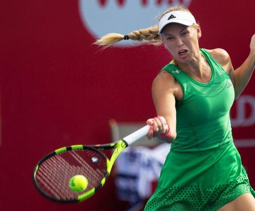 Ailing back forces No. 1 seed Caroline Wozniacki out at Strasbourg
