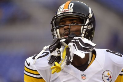 Former New York Giants WR Plaxico Burress hired as Arizona Cardinals coaching intern