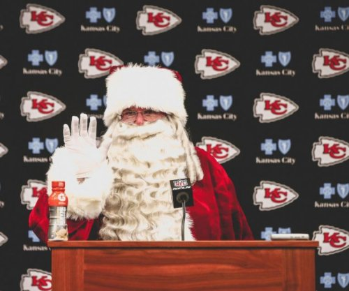 Andy Reid: Kansas City Chiefs coach plays Santa at postgame press conference
