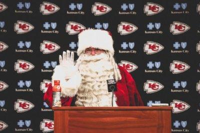 Andy Reid: Kansas City Chiefs coach plays Santa at postgame press conference