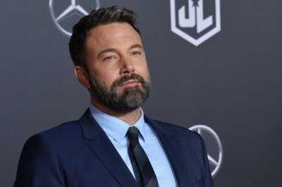Ben Affleck defends back tattoo: 'I'm very happy with it'