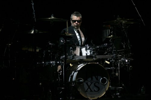 Australian rock band INXS says its touring days are over
