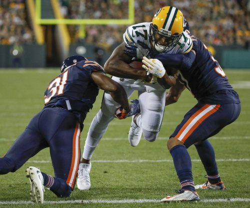 Green Bay Packers receiver Davante Adams stretchered off field