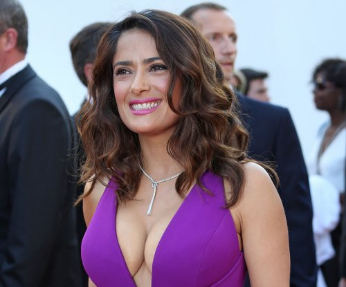 Salma Hayek embraces 'hot' label at age 48