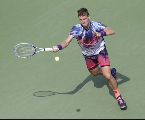 Tomas Berdych returns from layoff to win opener at Rotterdam
