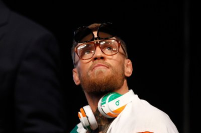 Mayweather vs. McGregor: 'Money' gets $100M purse, 'Notorious' claims $30M