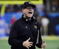 Michigan's Jim Harbaugh offers scholarship to 7th grade QB
