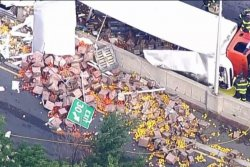 Truck crash covers New York City expressway in peppers