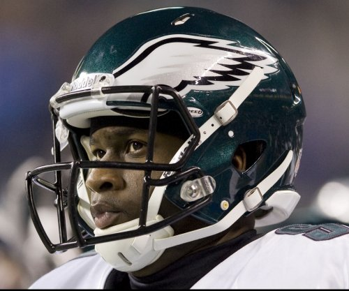 Vince Young to keep Texas job despite DWI arrest