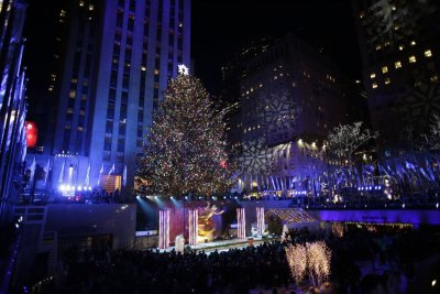 Rockefeller Christmas tree lights up to begin holiday season
