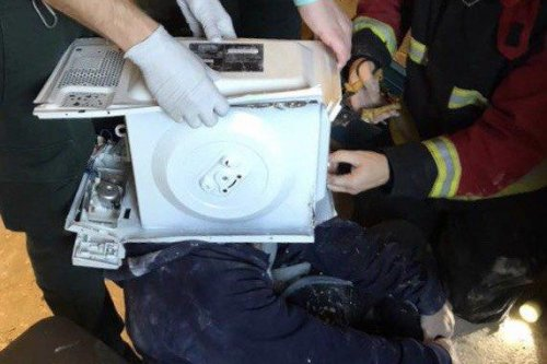 'Unimpressed' firefighters rescue man with microwave on head